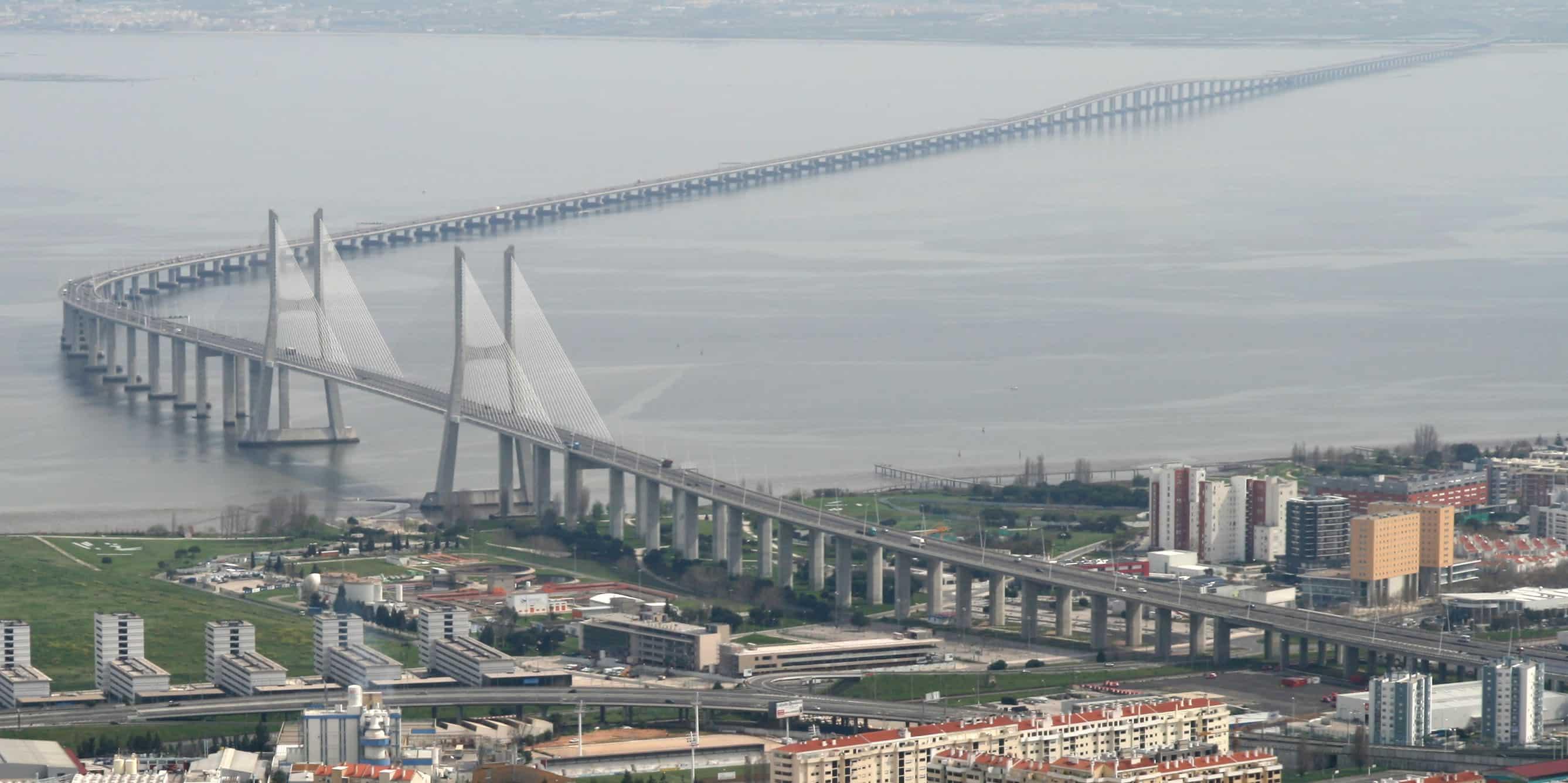 """Vasco da Gama Bridge aerial view"" by Till Niermann - Own work. Licensed under Creative Commons Attribution-Share Alike 3.0 via Wikimedia Commons - http://commons.wikimedia.org/wiki/File:Vasco_da_Gama_Bridge_aerial_view.jpg#mediaviewer/File:Vasco_da_Gama_Bridge_aerial_view.jpg"