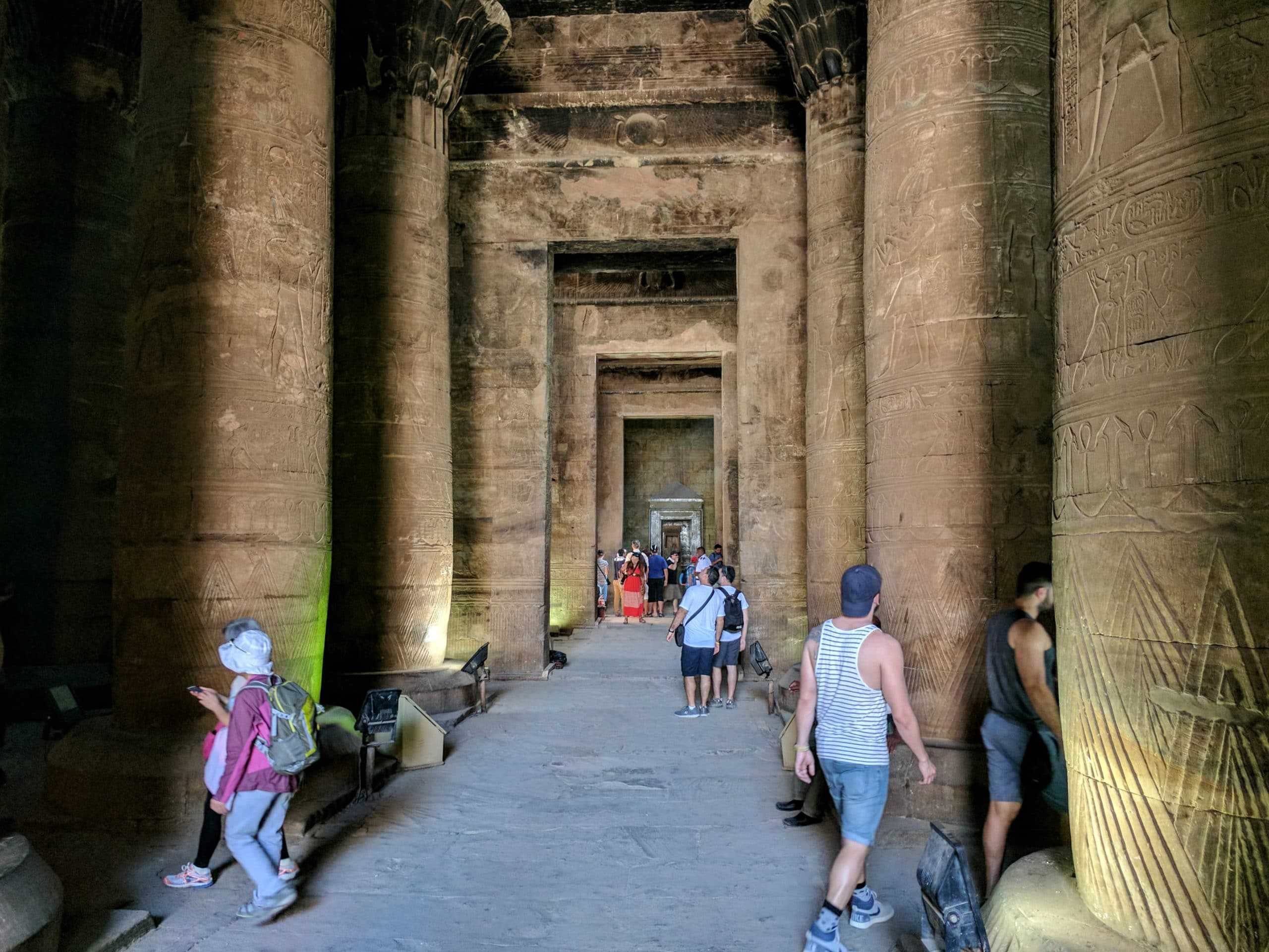 Men tourists walking on a temple in Egypt