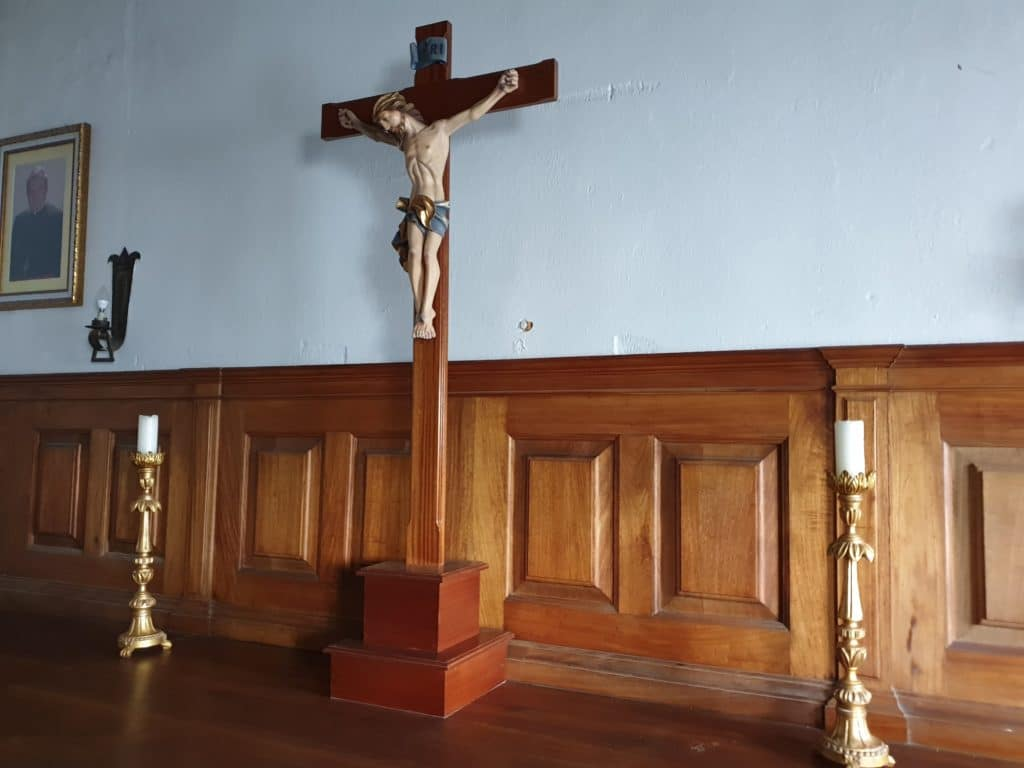 Inside the cathedral. A cross with Jesus.