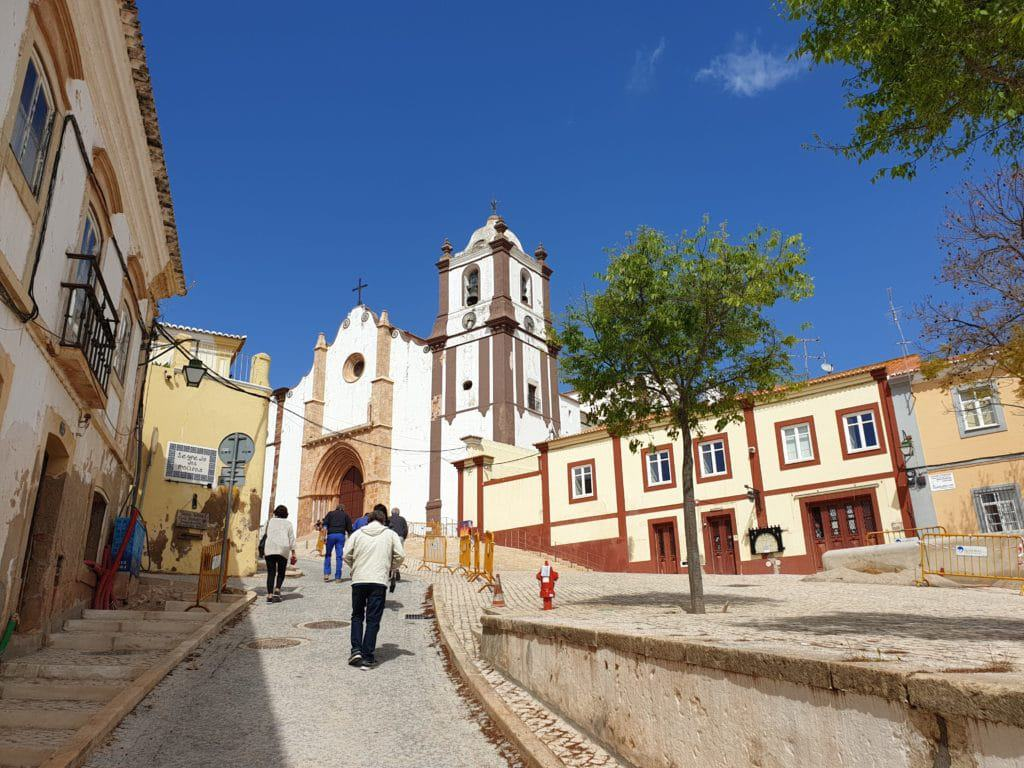Walking in the historic centre of Silves, with the Silves Cathedral in the background