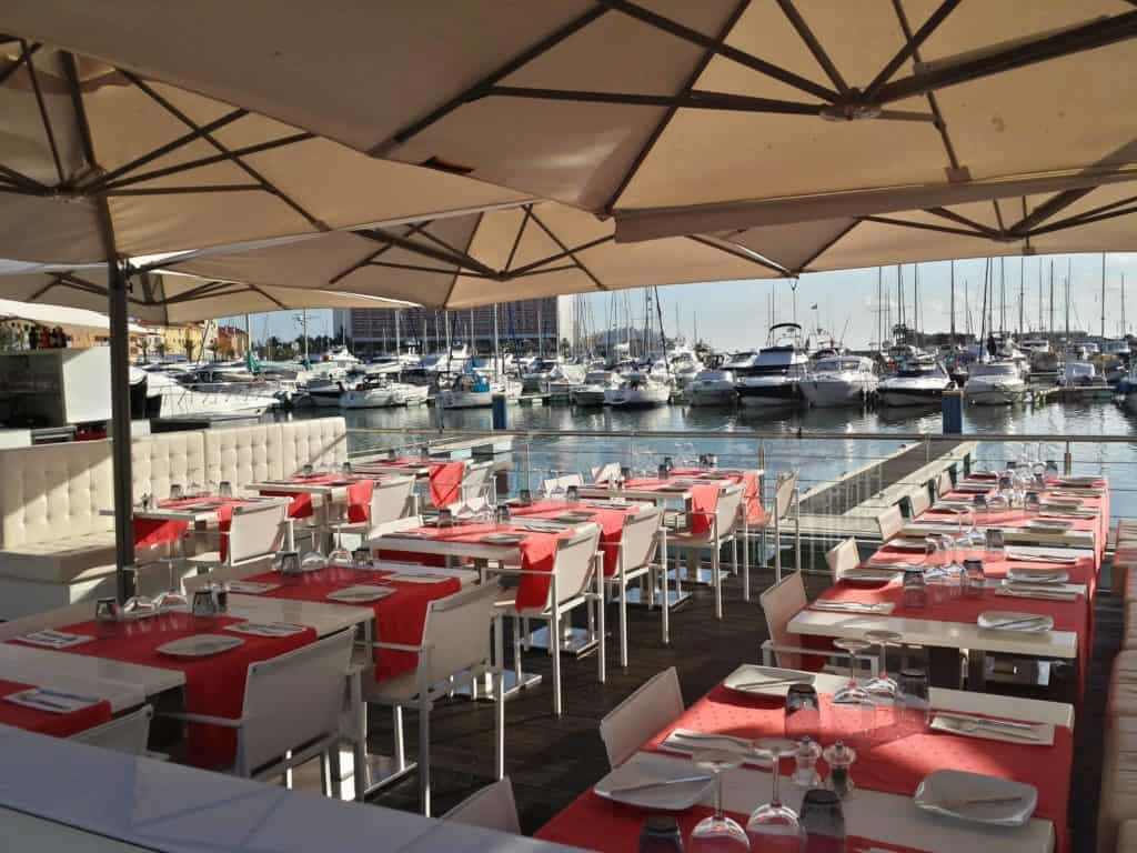 A restaurant in the marina of Vilamoura and the choice of when to visit the Algarve.