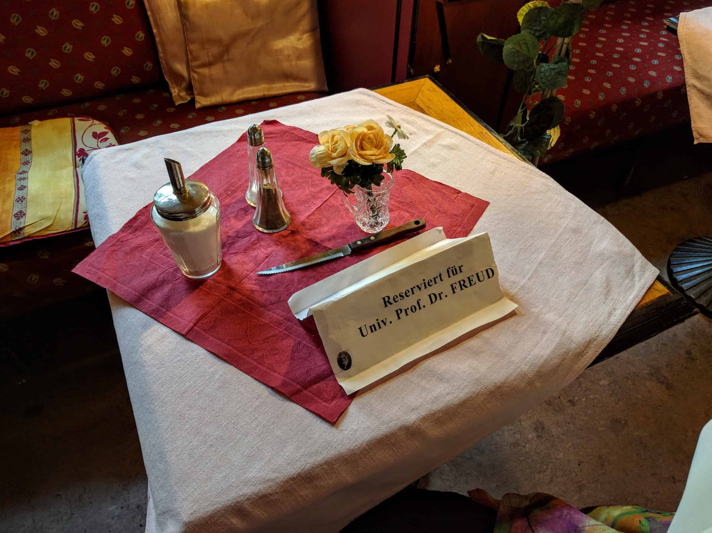 A table is reserved for Dr. Freud.