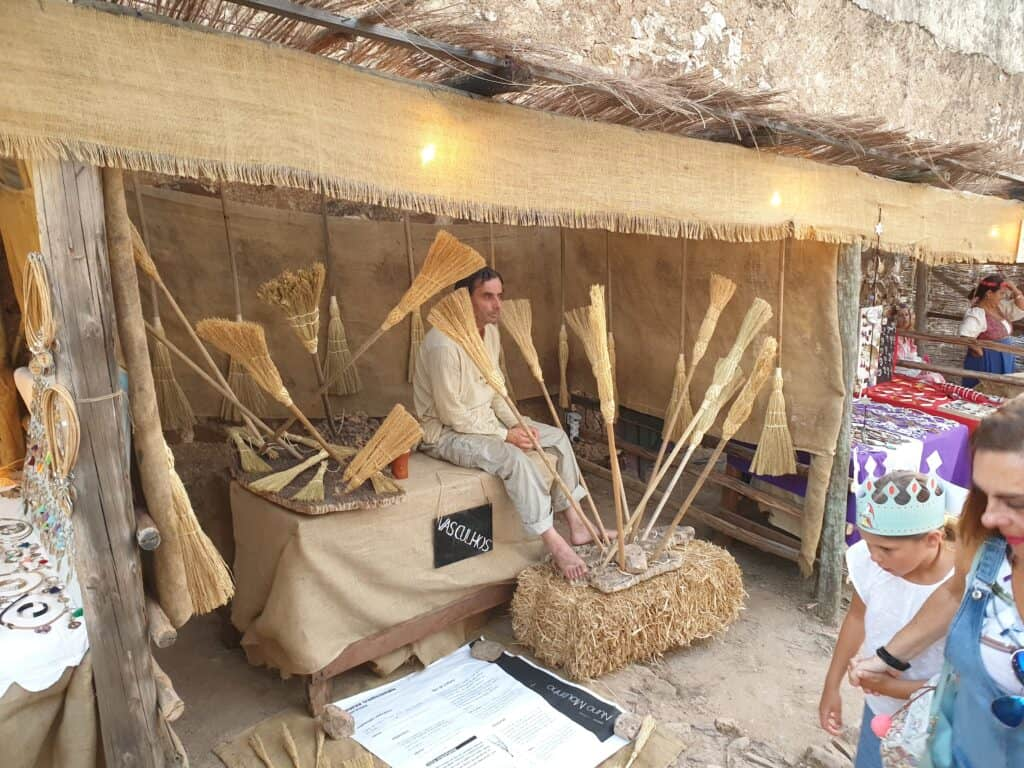 A seller of brushes inside the castle