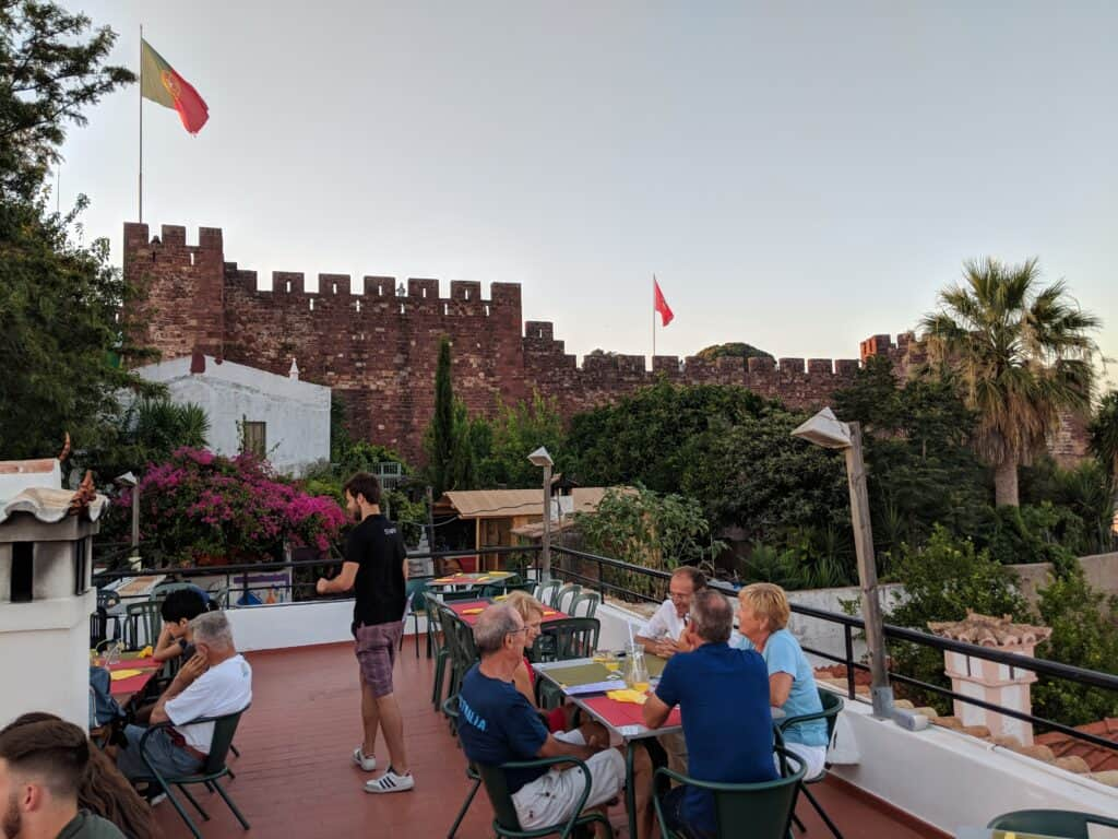 People in a restaurant see the castle