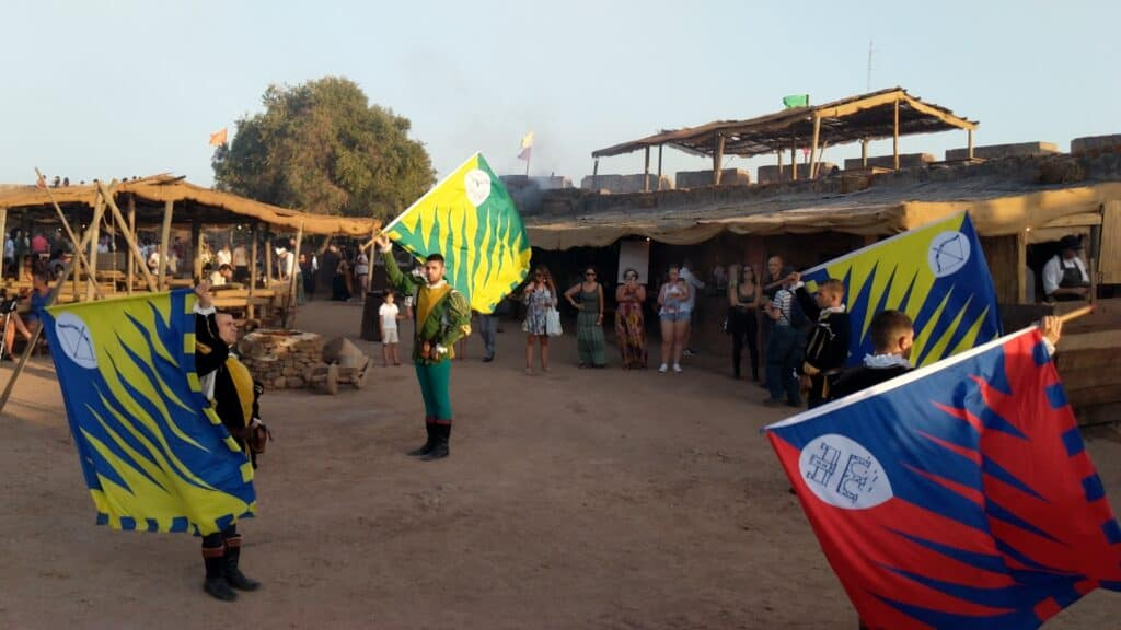 Inside the castle during the Medieval Fair in Portugal, in a show with flags