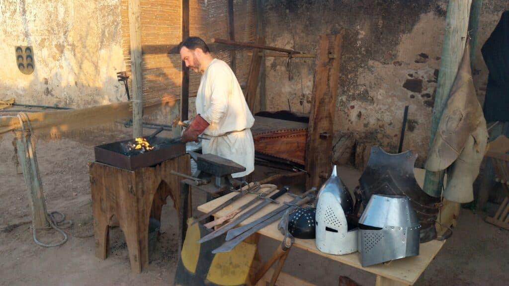 A man makes medieval instruments