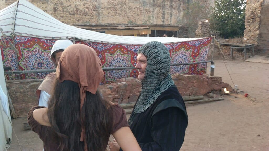 Visitors using medieval costumes